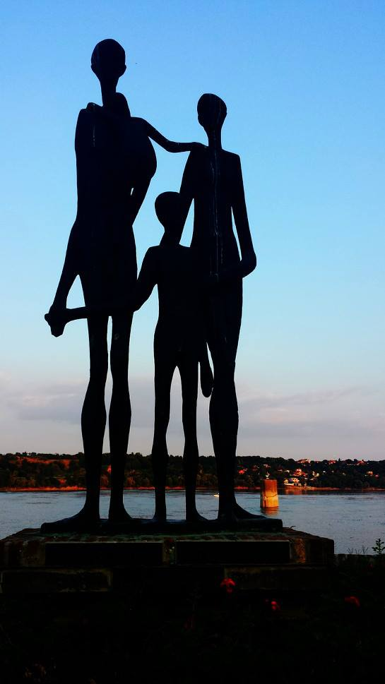 A statue family on the Danube at Sunset