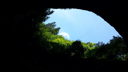 Looking up from the bottom of an underground cave